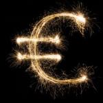Sparkler euro symbol on black background